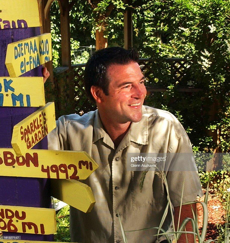 DENVER, COLORADO, JULY 6, 2004--Jerry Clum Stands Next To