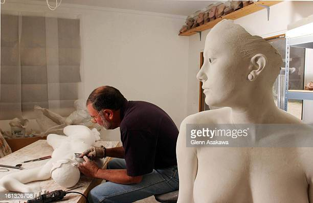 COUNTY COLORADO JUNE 23 2004John DeAndrea works in his Jefferson County home studio on a new realistic sculpture that will evenutally be cast in...