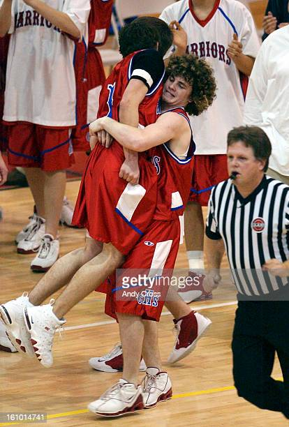COMARCH 2ND 2004Justin <cq> Schrenk <cq> #3 right picks up fellow Centaurus basketball player Zach <cq> Louth #1 in celebration of their victory over...