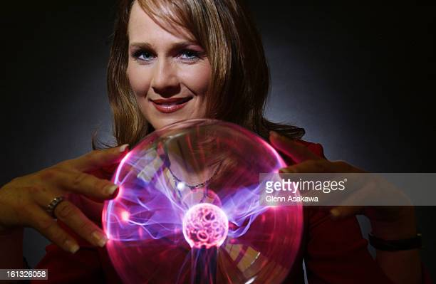 DENVER COLORADO MAY 7 2004Meteorologist Kathy <cq> Sabine <cq> of 9 News poses for a stylized portrait with an electrified 'plasma ball' in the...