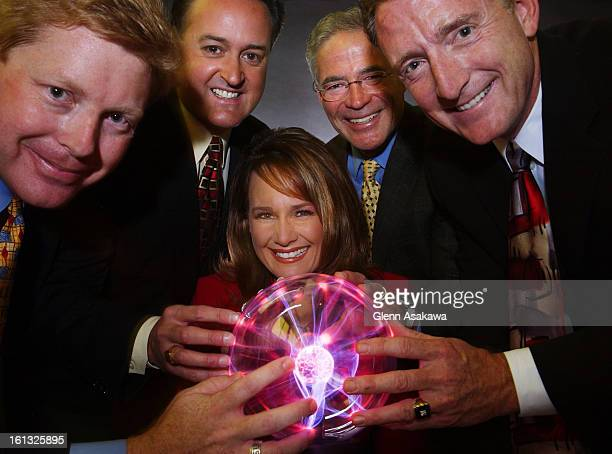 DENVER COLORADO MAY 7 2004Meteorologists from the local Denver affiliates pose for a stylized portrait with an electrified 'Plasma Ball' From left...