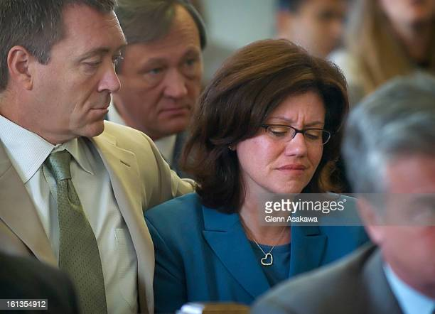 Anna <cq> VanderJagt <cq> , widow of Denver police officer Bruce VanderJagt <cq> , begins to cry as Lisl Auman <cq> offers a specific apology to...