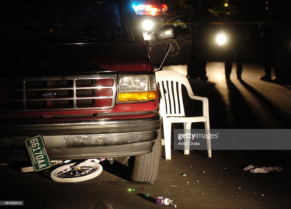 CO--AUGUST 26TH 2005--Denver Police investigate the scene of an