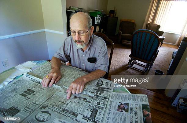 CENTENNIAL COLORADO AUGUST 25 2005Duncan McLean <cq> a retired United Airlines mechanic looks over the classifieds in his Centennial home for new job...
