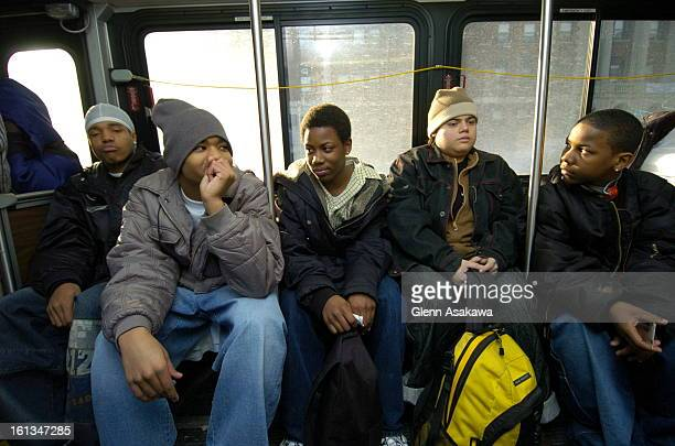 ISLANDJANUARY 24 2005Julius Searight center rides a city bus with friend Brandon Gowns <cq> left to the John Hope Settlement House a private...