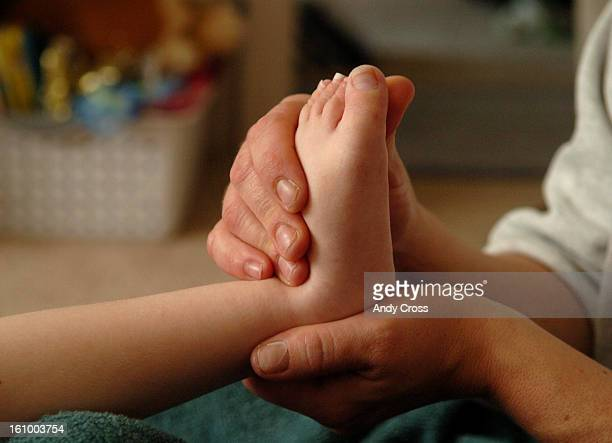 COOCTOBER 26TH 2005Kerri Bruning <cq> gives her son a foot massage after his bath Wednesday morning day four since his last feeding Dylan...