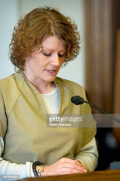 Lisl <cq> Auman <cq> reads from a written speech as she offers apologies to the surviving family of slain Denver police officer Bruce VanderJagt...