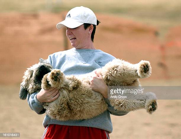 COMARCH 19TH 2005Maggie Drake <cq> holds her dog Maxine <cq> a 2yearold Wheaton Terrior at the Greenway Park offleash dog park enclosure <cq> near...