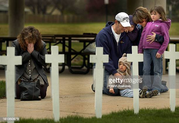 LITTLETON COLORADOAPRIL 20 2005Ruthie <cq> Owen <cq> of Denver left and the Beckman family pay their respects to the victims of the Columbine...