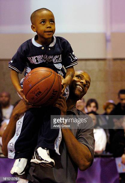 Seattle Super Sonic AllStar Ray Allen <cq> lifts up Devontay <cq> Tobe <cq> 6yearsold <cq> so he can shoot at the Radio Shack Shooting Stars Court at...