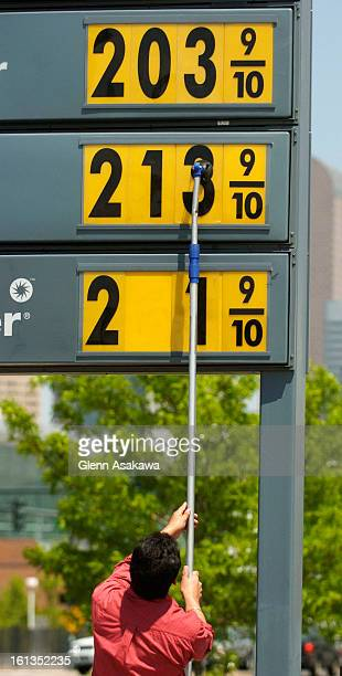 DENVER COLORADOMAY 25 2005Shell station employee Lali <cq> Dhillon <cq> lowers the price of all grades of gasoline by 6 cents on his signs Wednesday...