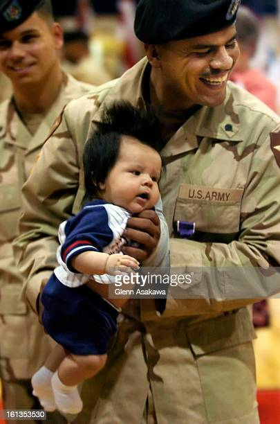 SPRINGS COLORADOJUNE 28 2005Specialist Johnny <cq> Escoto <cq> holds his 4monthold son Jerry after he received a Purple Heart Medal during a ceremony...