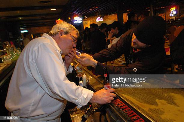Bartender Randy Malone gets a light from Mitch Sherman just as the bar closed Smoking in all bars in Denver is now prohibited so many patrons partook...