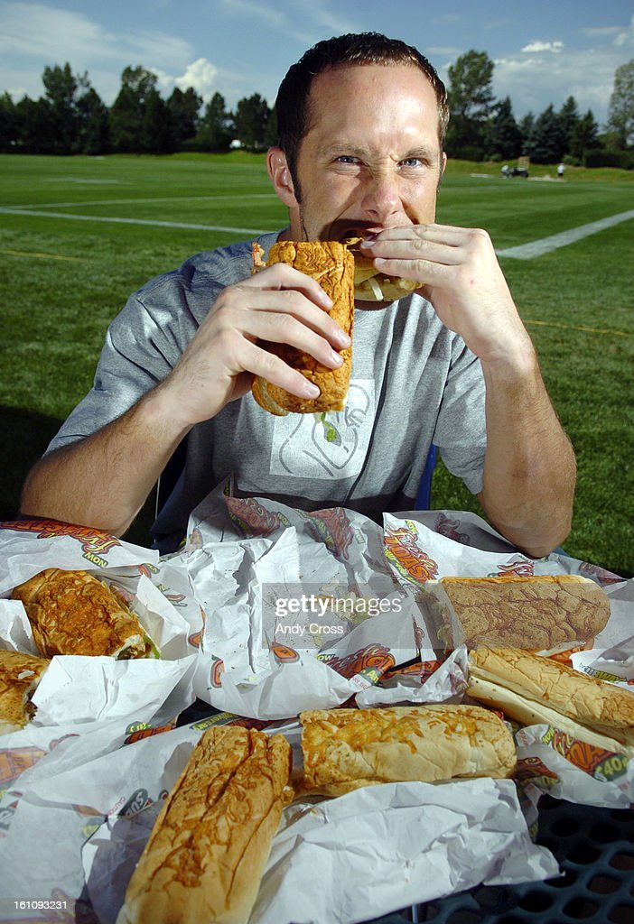 CENTENNIAL,CO--AUGUST 15TH 2006--Denver Broncos wide receiver, David Kircus, <Cq> eats a Subway sandwich, his presonal favorite; a Roasted Chicken Breast with bacon and salami, <cq> after training camp Tuesday morning at Dove Valley. Kircus worked for Sub : News Photo
