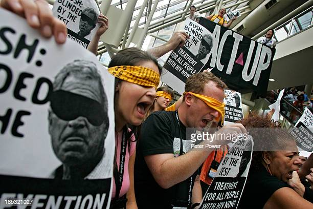 Protestors from ACT UP did a short but loud protest on the second level of the Toronto Convention Centre on Monday afternoon Many were wearing...