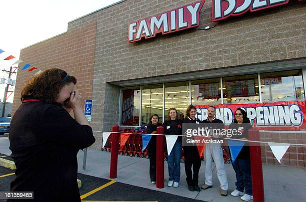 DENVER COLORADOJANUARY 12 2006Sharon <cq> Boehmer <cq> district manager for Family Dollar stores takes a photo of the staff cutting a ribbon to...