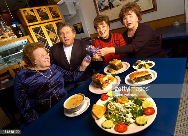 DENVER COLORADOAPRIL 26 2006While shouting 'Opah1' Yanni <cq> Stavropoulos <cq> second from left shares a toast of ouzo with his mother Georgia <cq>...
