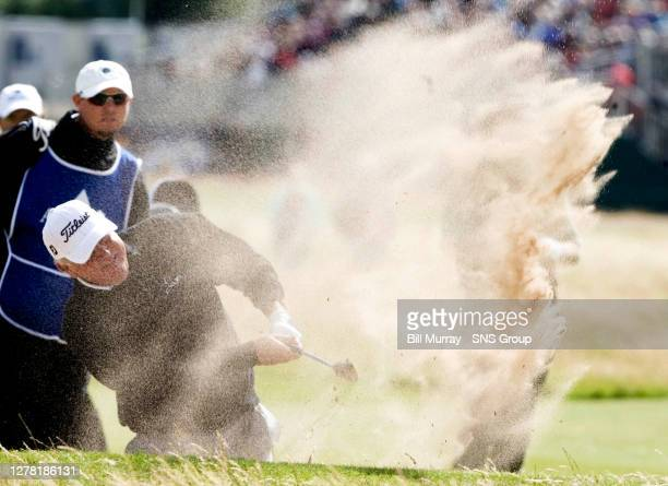 America's Mark O'Mera splashes out of the 10th green fairway bunker
