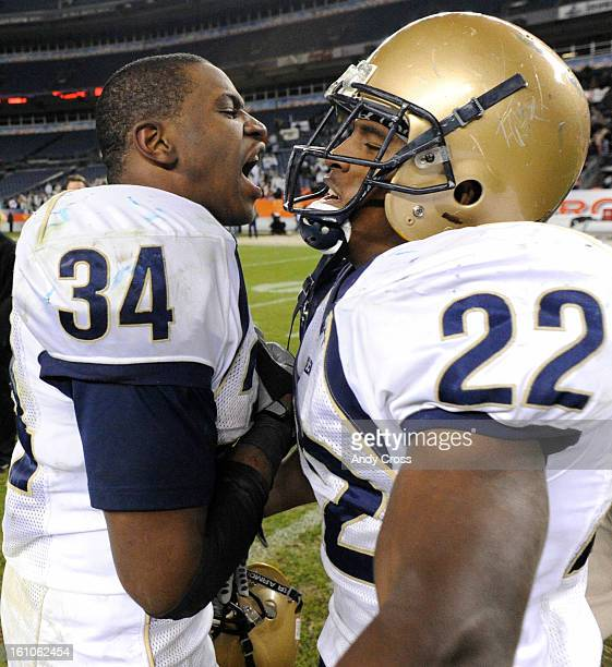 DENVERCONOVEMBER 29TH 2008Adonis AmeenMoore #34 left celebrates with teammate Josh Ford after defeating Cherry Creek in the 5A State Football...
