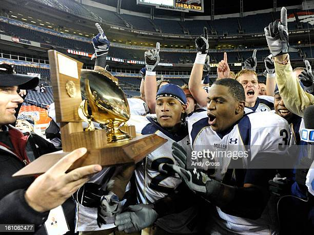 DENVERCONOVEMBER 29TH 2008Adonis AmeenMoore #34 receives the 5A Championship trophy after defeating Cherry Creek in the 5A State Football...