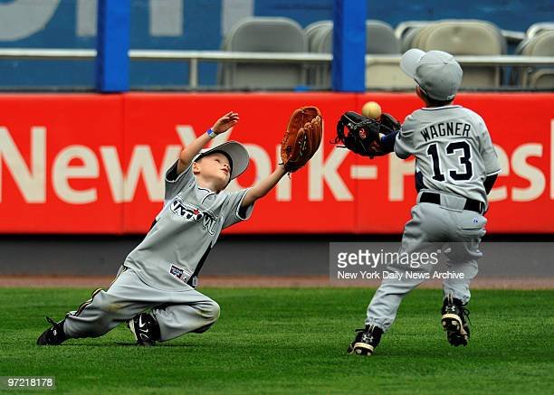 All Star Game at Yankee Stadium., Home Run Derby Night., Brewers Ben Sheets son Seaver,6 and Mets Billy Wagner's son Jeremy , catch fly balls.