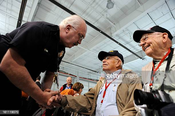 DENVER COAPRIL 28TH 2009Denver Police Officer John Super <cq> left shakes hands with WWII Veterans John Pocock Pearl Harbor survivor center and David...