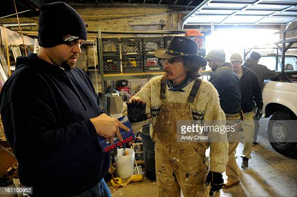 DENVER COJANUARY 28TH 2009Douglas Fowler right talks with Jason Stutzman <cq> home maintenance and repair manager for Brothers Redevelopment Inc at...