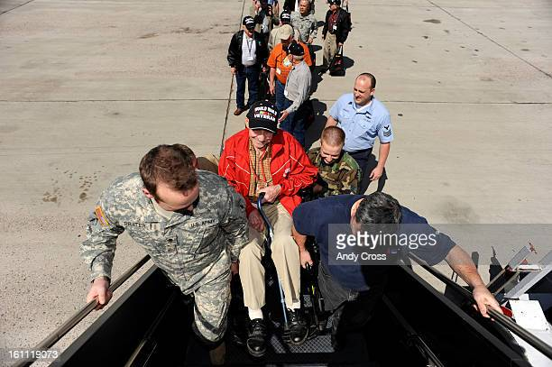 DENVER COAPRIL 28TH 2009Ervin Schlepp World War II Veteran Navy gets helped up the steps to a US Airways aircraft Tuesday morning at the Signature...