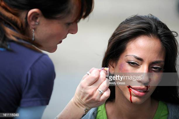 COAPRIL 14TH 2009Local makeup artist Arianne Meade <Cq> applies makeup to actress Jessica Rizo's face before a shooting a scene for the movie...