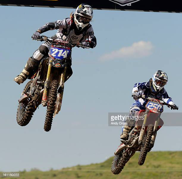 LAKEWOOD COJUNE 27TH 2009Motocross racer Vicki Golden #214 16yearsold from El Cajun California left gets air heading off a jump against Jessica...