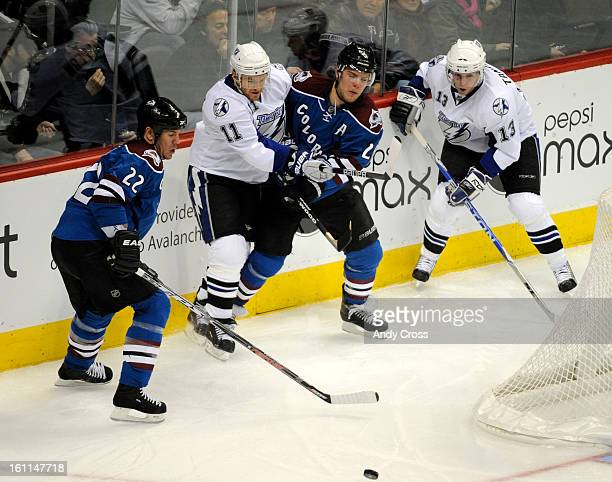 CODECEMBER 1TH 2009Paul Stastny battles Jeff Halpern #11 Tampa Bay Lightning for control of the puck as Scott Hannan left Av's and Alex Tanguay...