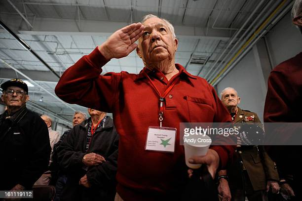 DENVER COAPRIL 28TH 2009Roland Young center salutes during ceremonies at Signature Flight Support at DIA Tuesday morning 131 World War II Veterans...