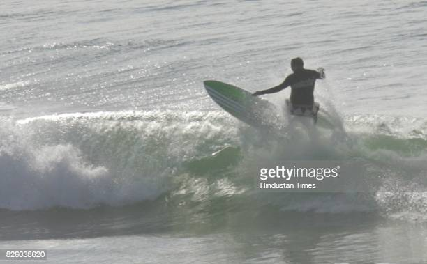Sea Surfer Surfing on the waves of Indian ocean on the north beach of Durban on WednesdayHundreds of Surfers enjoyed surfing today as city witnessed...