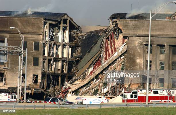 A 200foot gash exposes interior sections of the Pentagon following a suspected terrorist crash of a hijacked commercial airliner into the Pentagon...