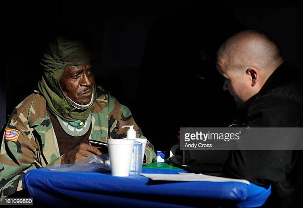 DENVER CONOVEMBER 4TH 2010Army Veteran Vietnam ara Amos Brown left talks with VA Ratings Specialist Zack Wilson at the 20th annual Homeless Veterans...