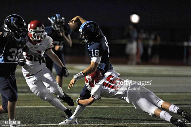RANCH COSEPTEMBER 3 2010Brock Berglund dodges Regis' Drake Thenell while running with the ball for a down at the Valor Christian High SchoolRegis...