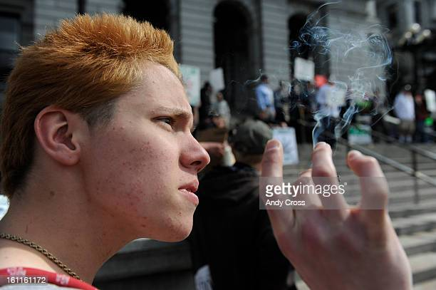 COMARCH 4TH 2010Cameron Stanley 18yearsold smokes marijuana on the west steps of the State Capitol in support of a medical marijuana rally Thursday...