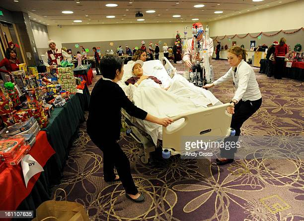 AURORA CODECEMBER 3RD 2010Children's Hospital staff Child Life Specialist Tommi McHugh left and nurse Erin Clark right along with nurse Andrea Polito...