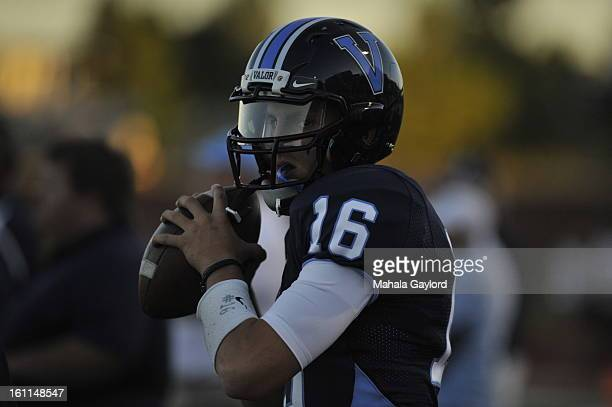 RANCH COSEPTEMBER 3 2010Christian Valor quarterback Brock Berglund stays warm on the sidelines at the beginning of the Valor Christian High...