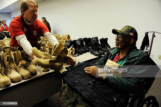 DENVER CONOVEMBER 4TH 2010Kevin Eherenman left hands retired US Navy Lt Commander Raymond Hines a pair of boots at the 20th annual Homeless Veterans...