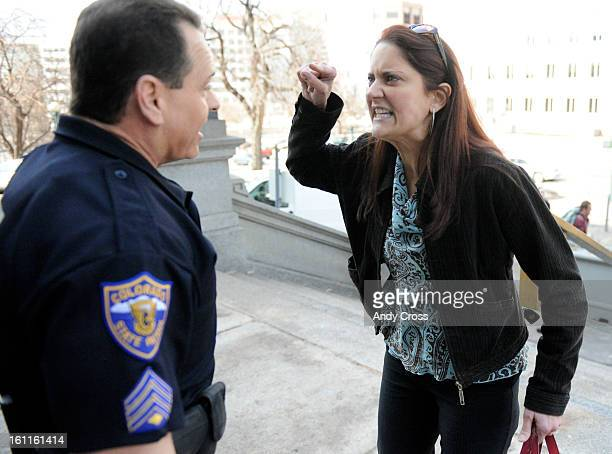 COMARCH 4TH 2010Medical marijuana advocate Carla MaloneBoyd gets in the face of a Colorado State Patrol officer on the north side of the State...