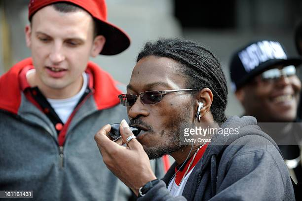 COMARCH 4TH 2010Medical marijuana advocate Zion Gray from Orlando Florida center smokes marijuana from a glass pipe on the west steps of the State...