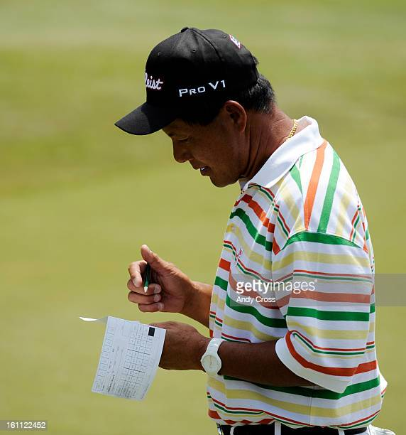 COMAY 28TH 2010Professional golfer Chien Soon Lu writes on his scorecard after finishing up on the 18th hole during the second round of the 71st...