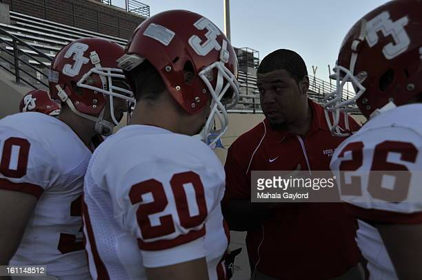 RANCH COSEPTEMBER 3 2010Regis Jesuit Assist Coach Cotlen Johnson gives a pep talk to players from left Ryan Myers Jordan Jungers and Andrew Faggella...