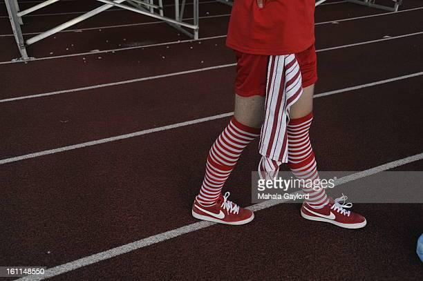 RANCH COSEPTEMBER 3 2010Regis Rowdy Brad McWilliams walks past fans before the starts of the Valor Christian High SchoolRegis High School football...