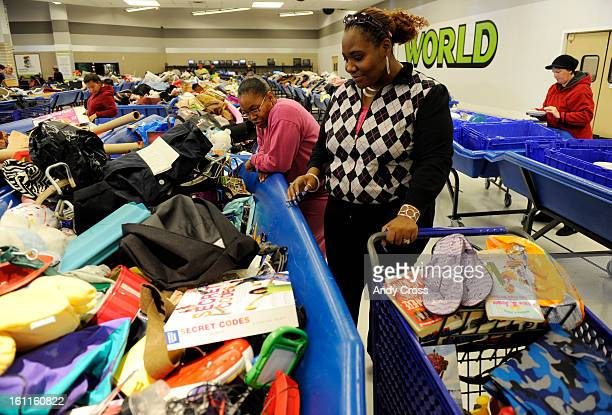 COMARCH 2ND 2010Tamara Boykins left and her sister Tankeea Wall from Montbello search through bins of clothing toys and household goods at the...