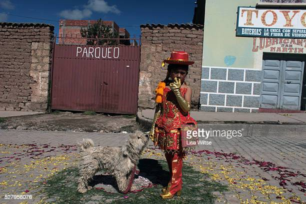 Virgen de la Candelaria. A young girl waits to parade through the streets of Copacabana during the Fiesta de la Virgen de la Candelaria is held to...