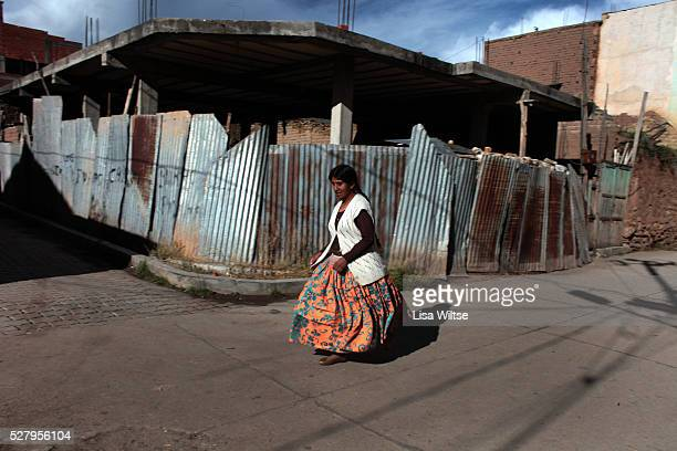 Virgen de la Candelaria A young woman runs through the streets of Copacabana during the Fiesta de la Virgen de la Candelaria is held to honour the...