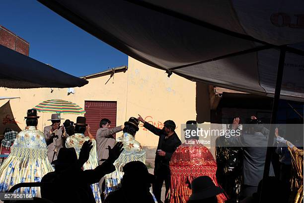 Virgen de la Candelaria Aymarans drink and dance during the Fiesta de la Virgen de la Candelaria is held to honour the Virgen or the Dark Virgin of...