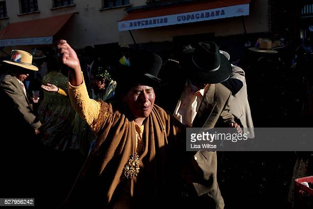 Virgen de la Candelaria. Aymarans drink and dance during the Fiesta de la Virgen de la Candelaria which is held to honour the Virgen or the Dark...